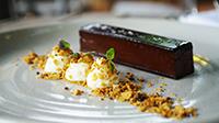 Chocolate pave, toffee cream, sour cream mousse, peanut crumble